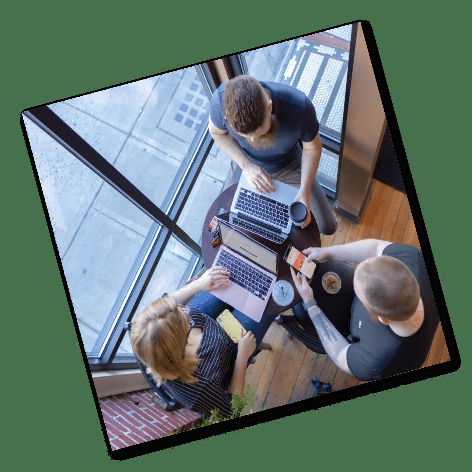 Three people working on laptops in coffee shop in Yakima Washington
